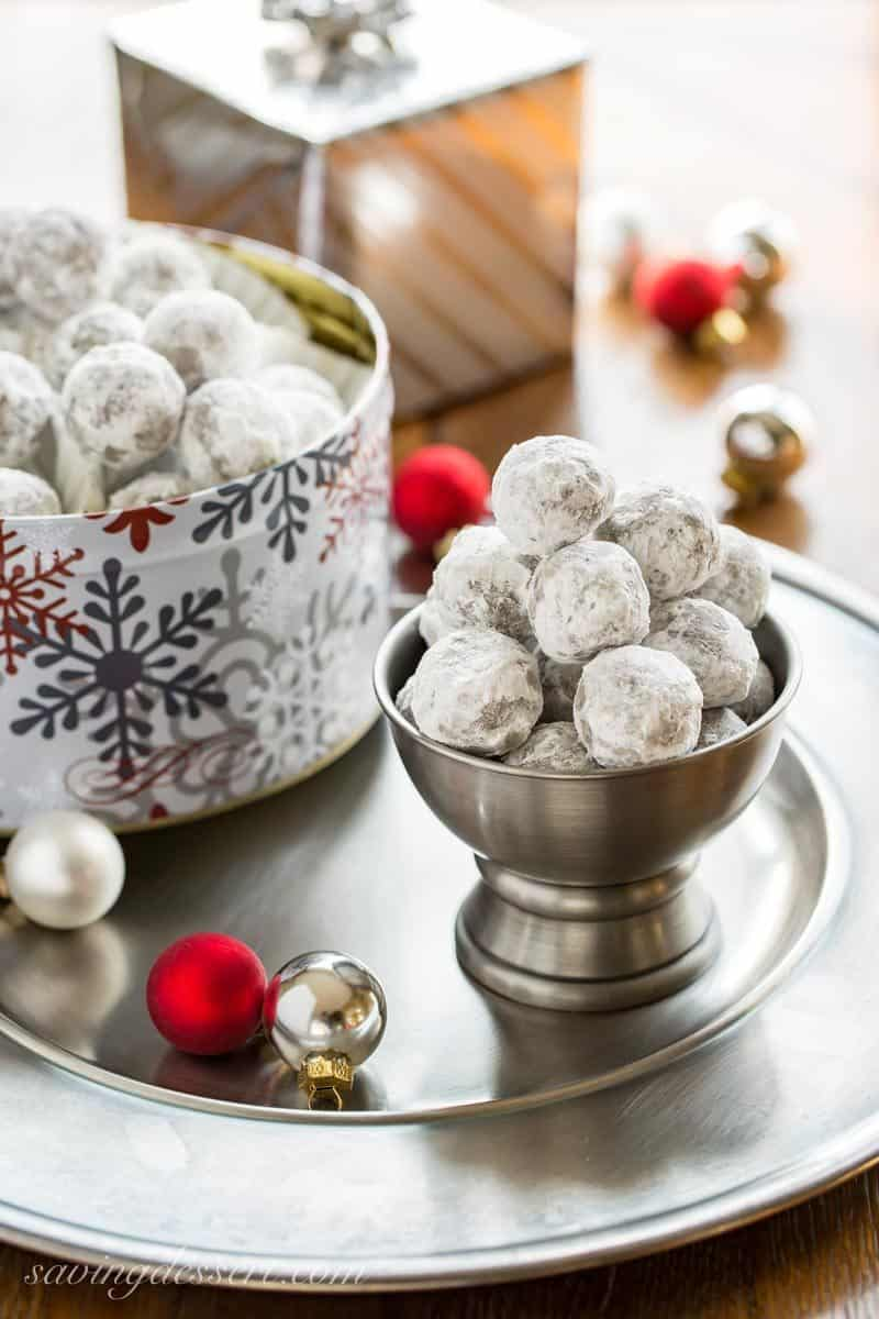 Bourbon Balls ~ an easy no-bake cookiethat's been a family favorite for generations. Grab a bottle of your favorite bourbon or rum and mix up these delicious grownup holiday treats. www.savingdessert.com #savingroomfordessert #bourbon #bourbonballs #rumballs #nobakecookies #holidaytreats