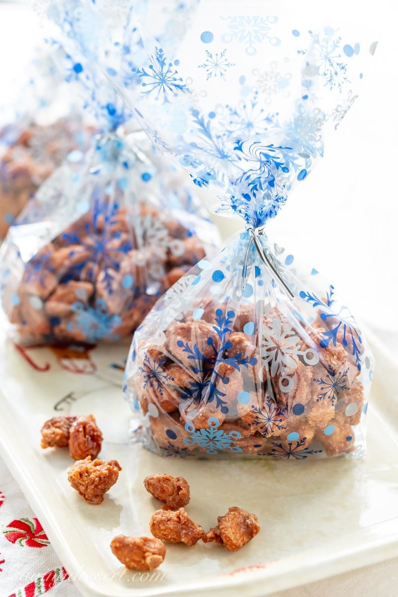 a few clear holiday bags of burnt sugar cinnamon almonds ready for gifting