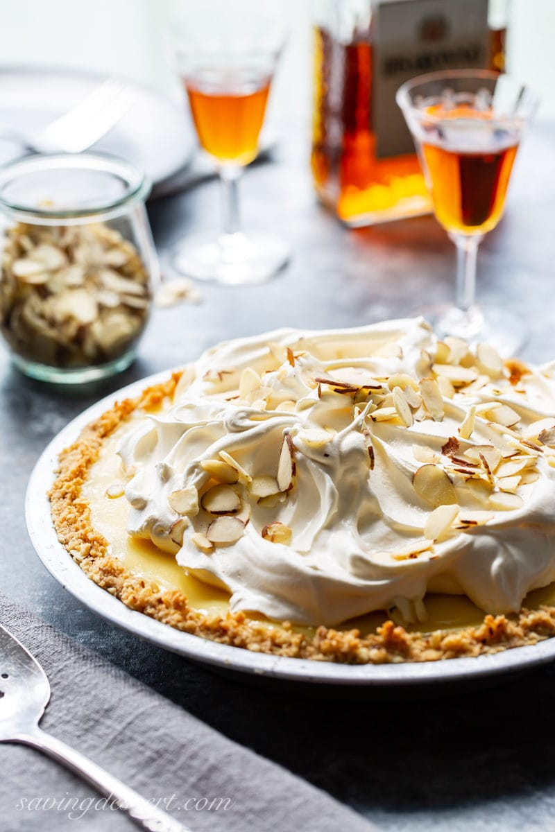 Amaretto Cream Pie topped with whipped cream and almonds served with amaretto liqueur