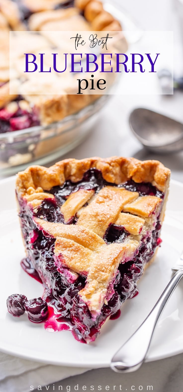 A slice of a lattice topped pie with blueberry filling