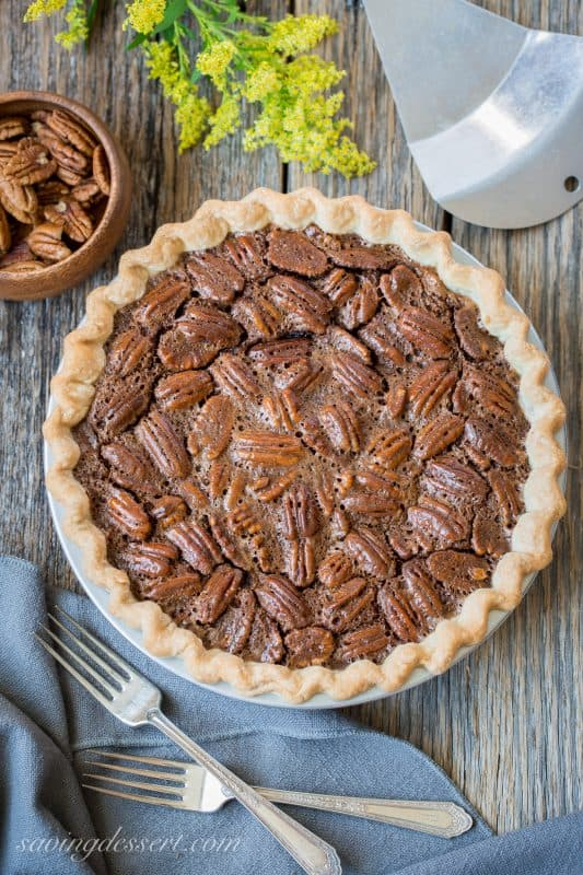 Chocolate Pecan Pie - Fudgy and rich, this is an easy pie to make and everyones favorite during the holidays. www.savingdessert.com