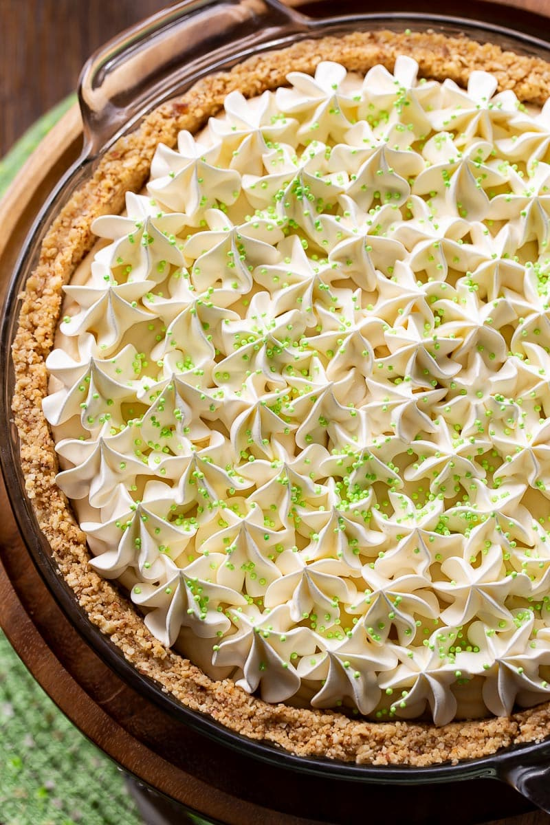 A creamy Irish cream pie topped with whipped cream and green sprinkles