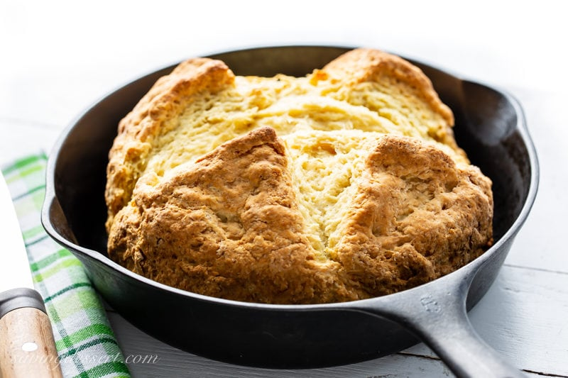 A cast iron skillet with a loaf of Irish Soda Bread