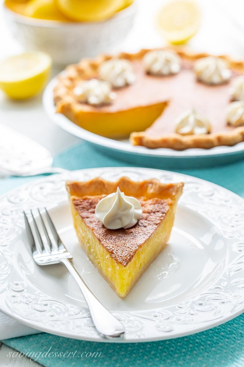 A slice of lemon chess pie with whipped cream on top