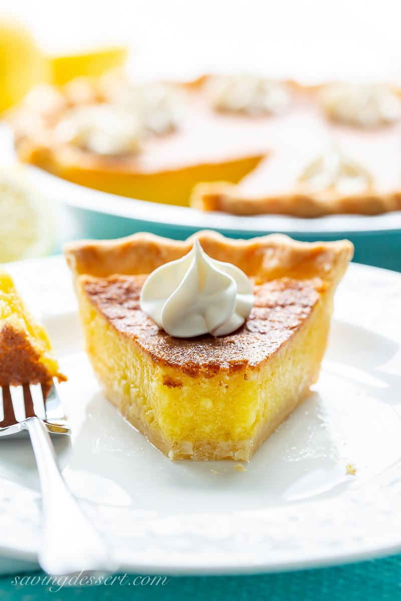 A piece of lemon chess pie with a golden brown top and bright yellow filling