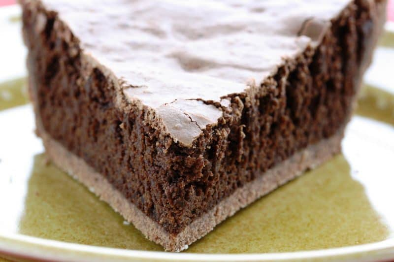 Mississippi Mud Pie - a deliciously light pie with a nice chocolate flavor, crunchy top and soft cake-light middle wrapped up in an easy chocolate crust www.savingdessert.com