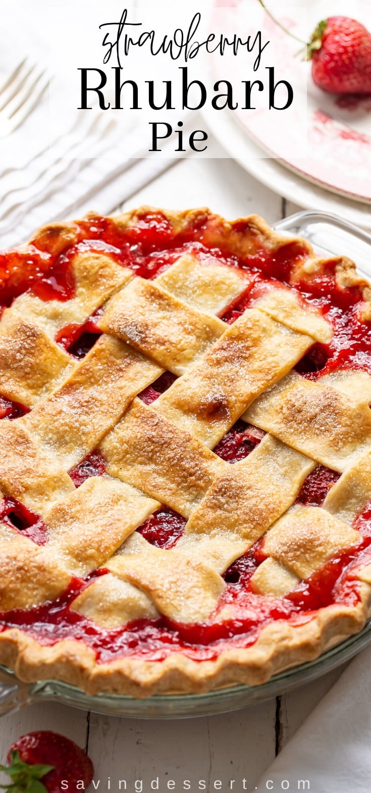 A lattice topped strawberry rhubarb pie with loads of red juices between the crust