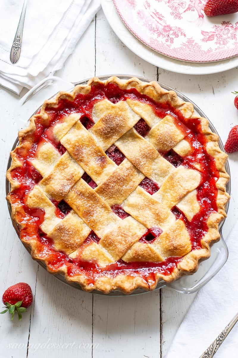 An overhead view of a lattice crust pie with red juices bubbled up around the edges
