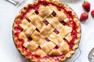 A closeup overhead view of a strawberry rhubarb pie