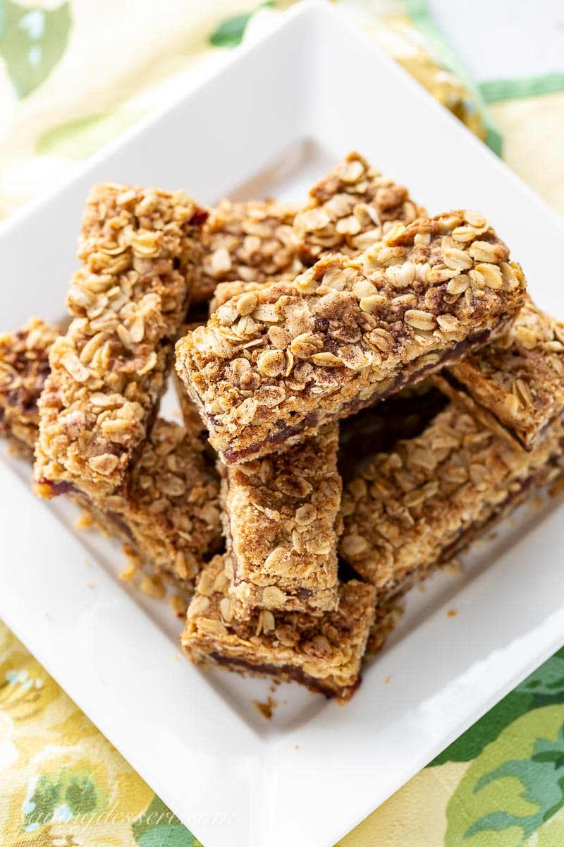 Overhead view of a plate of date bars topped with oats and cinnamon