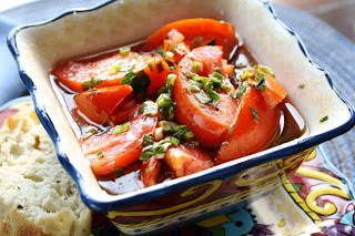 A delightful dish of fresh garden tomatoes and herbs. Marinated and served with crusty bread to soak up all the juices