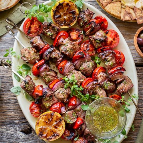 Grilled Lamb Souvlaki skewers with tzatziki, olives, pita bread and hummus