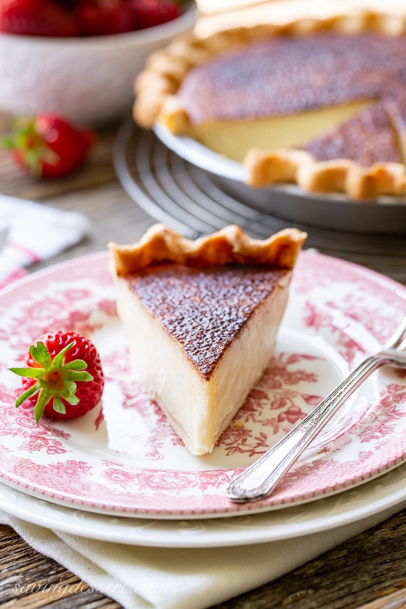 A slice of sugar pie served with a strawberry
