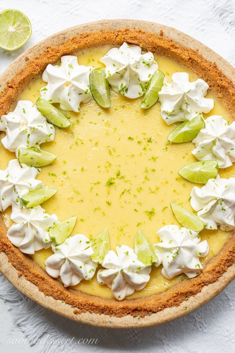 Key Lime Pie with Whipped Cream, Lime Zest and sliced key limes
