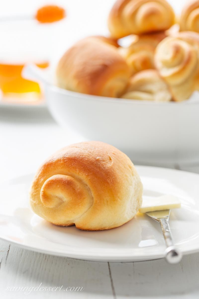 Homemade spiral Lion House Rolls with a pat of butter