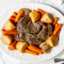 A slow cooker pot roast with potatoes and carrots