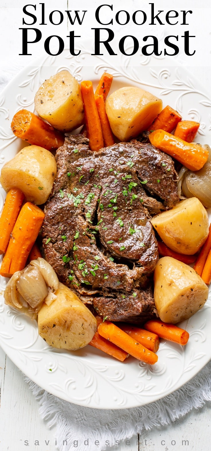 A platter with slow cooker pot roast with potatoes and carrots