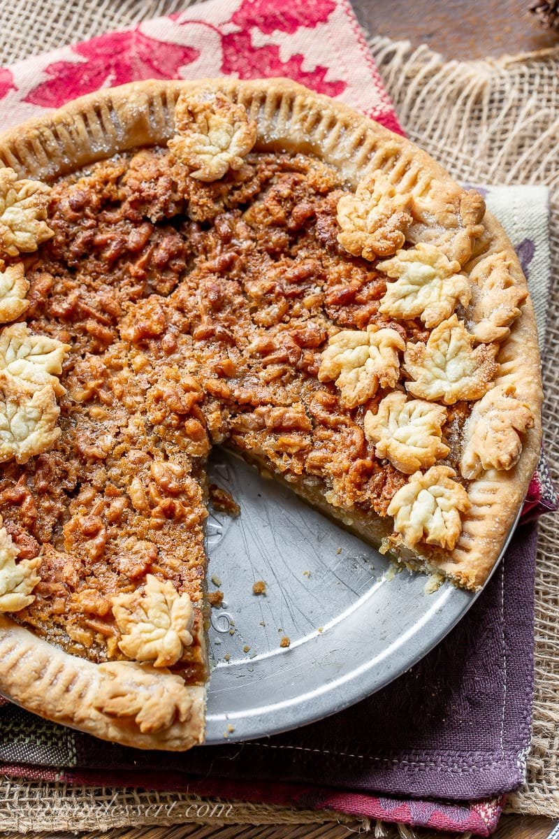 A sliced maple walnut pie with crust cookies on top