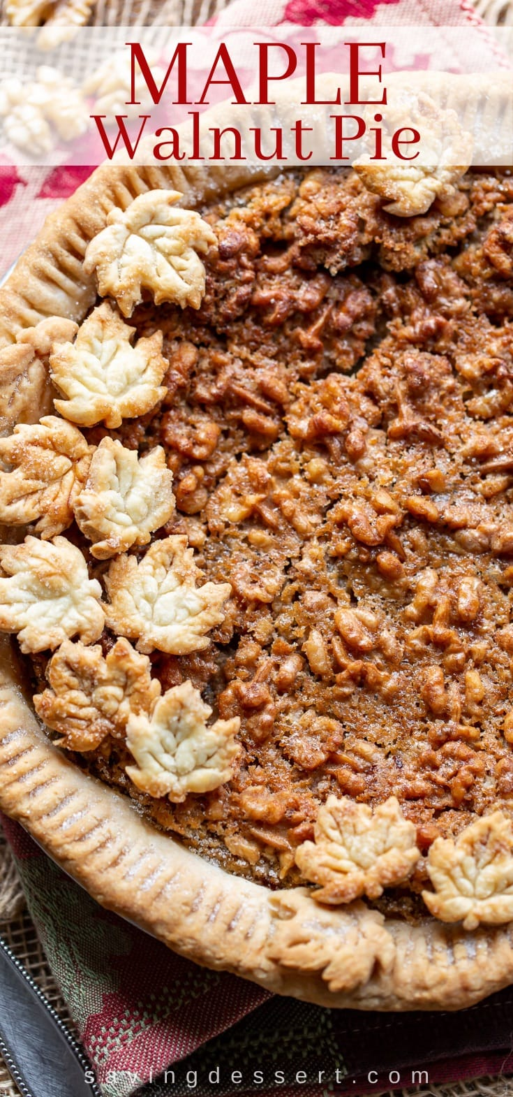 A close up of a maple walnut pie topped with crust cookies in the shape of leaves