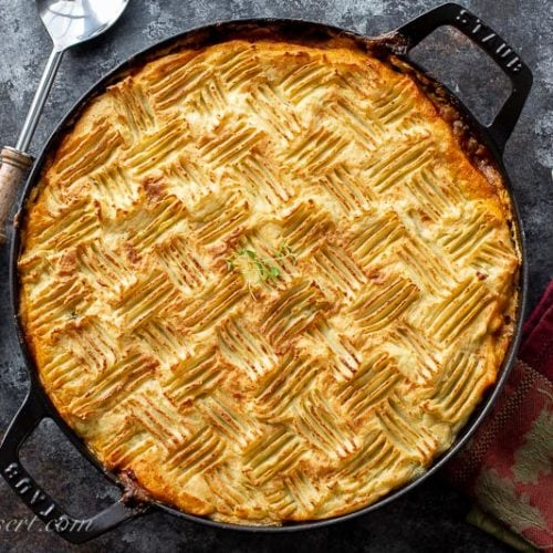 Cottage pie topped with mashed potatoes lightly browned