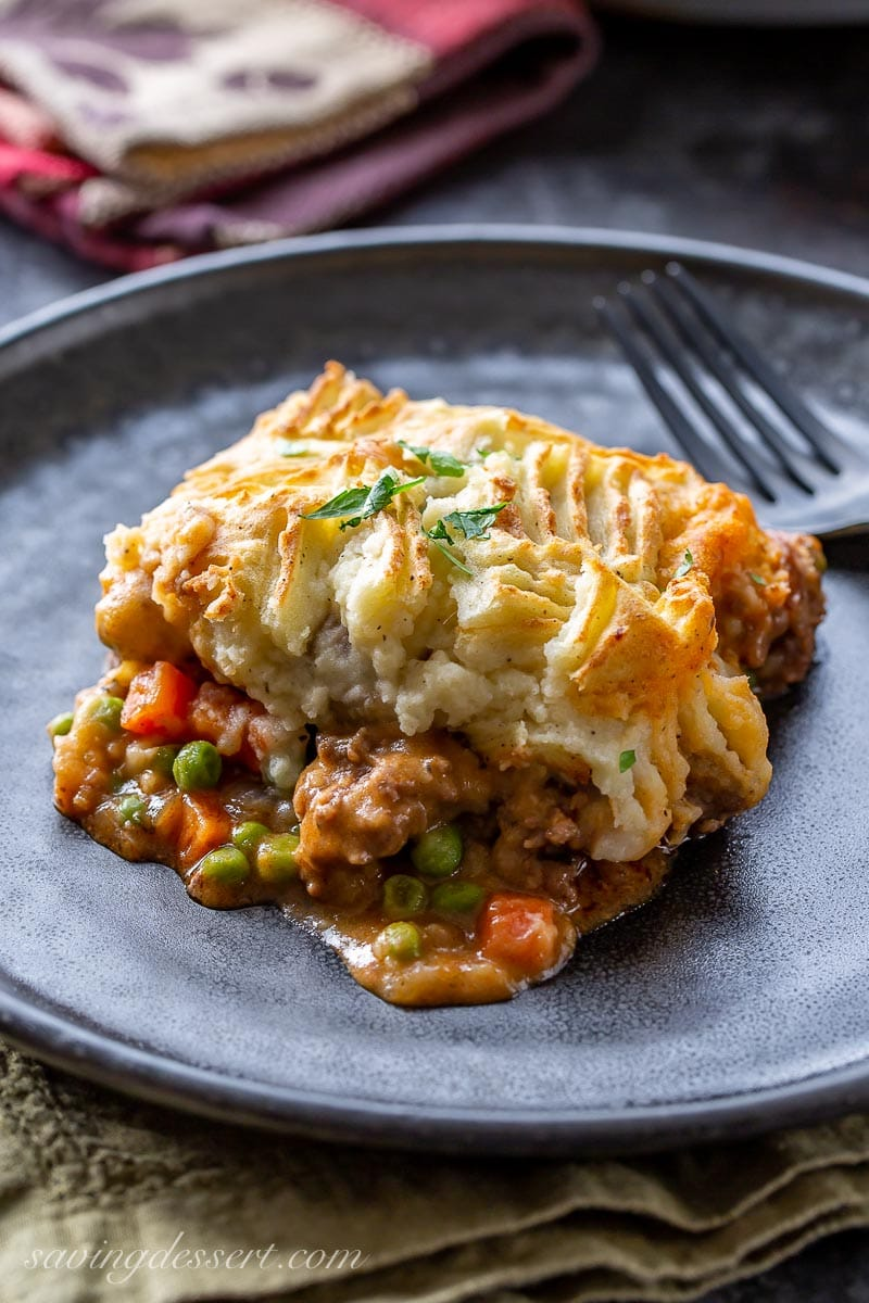A hearty helping of cottage pie with beef, carrots, peas and mashed potatoes