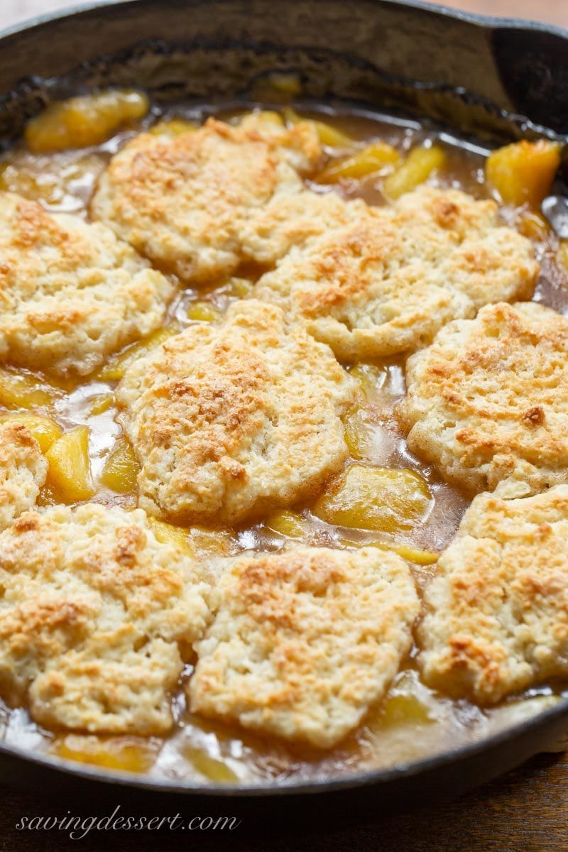 Old fashioned skillet peach cobbler with a shortcake biscuit crust