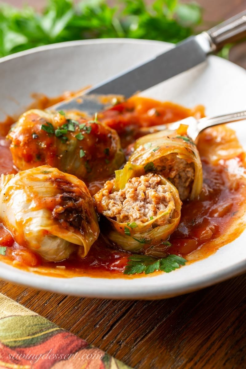 Cabbage rolls made with ground bee in a bowl with rich tomato sauce