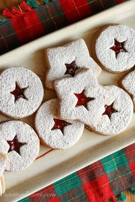 a platter of Old World Linzer Cookies dusted with powdered sugar