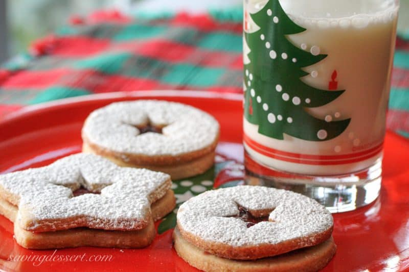 Old World Linzer Cookies on a plate with milk