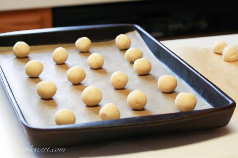 cookie dough balls on a baking sheet