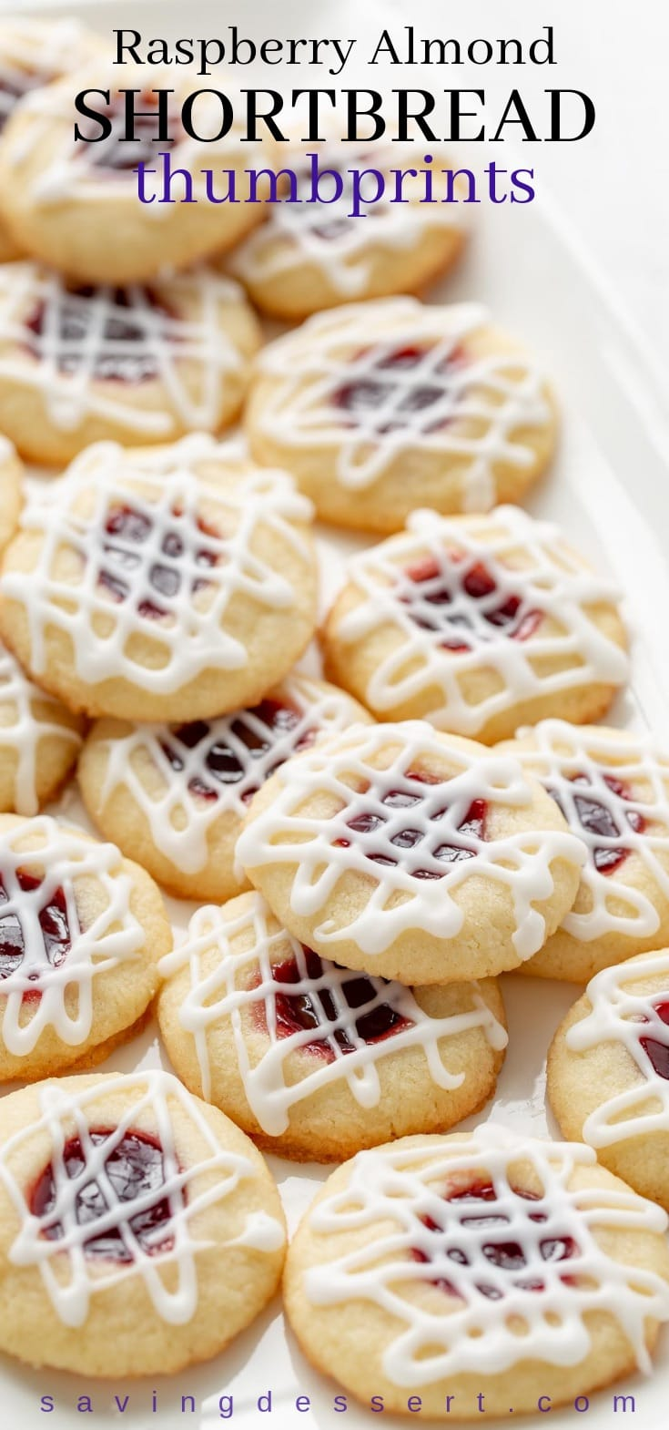 Raspberry Almond Shortbread Thumbprint Cookies - a tender shortbread cookie packed with raspberry jam and topped with a simple almond flavored icing. #cookies #raspberryalmondshortbreadthumbprint #thumbprint #cookies #holidaycookies #holidaybaking #shortbread #raspberry