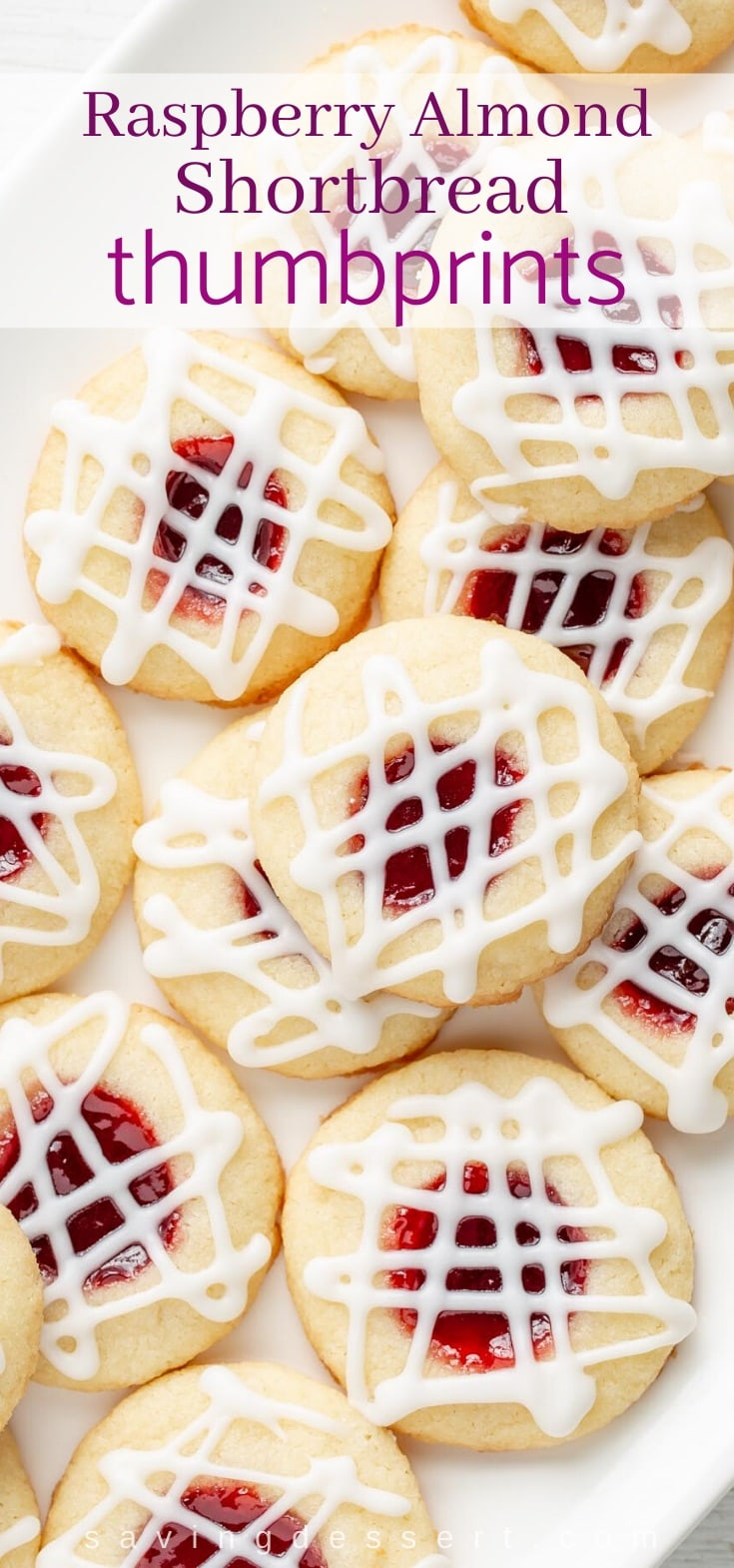 A platter of raspberry jam filled cookies topped with a drizzle of icing