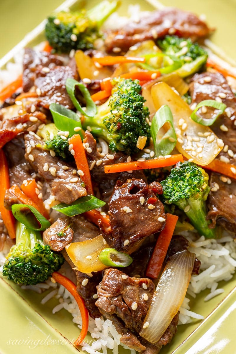 A close up of a plate of beef and broccoli over rice