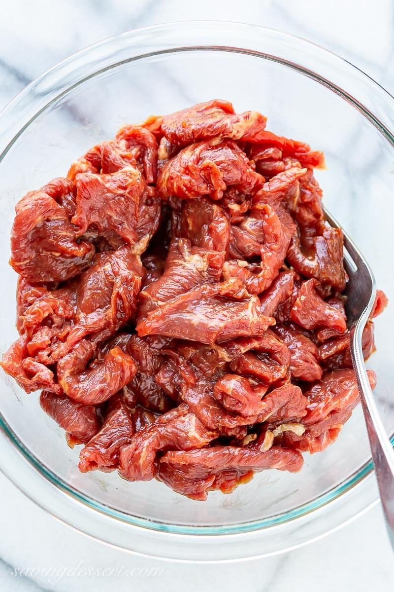 A bowl of sliced sirloin marinated in soy sauce