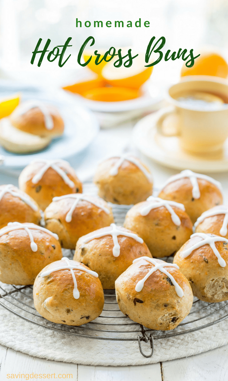 Hot Cross Buns - lightly sweet, orange scented yeast rolls with currants, raisins and plenty of warm spices. A traditional treat served during Lent and the Easter holidays. www.savingdessert.com #savingroomfordessert #hotcrossbuns #sweetbuns #buns #hotcross #easter #brunch #raisinrolls #holidaybaking