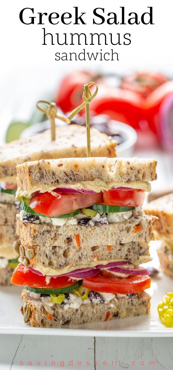 This might look like a plain old veggie sandwich, but it's so much more! The Greek flavors are bright, briny, crisp, fresh and delicious! #hummussandwich #greeksaladsandwich #greeksandwich #vegetariansandwich #makeaheadsandwich #picnicsandwich #greekfood