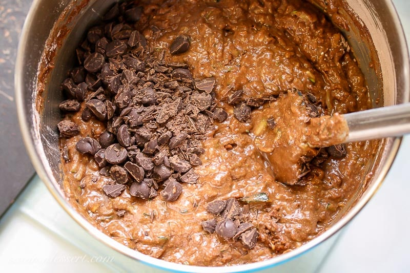 A bowl of chocolate cake batter with chocolate chips