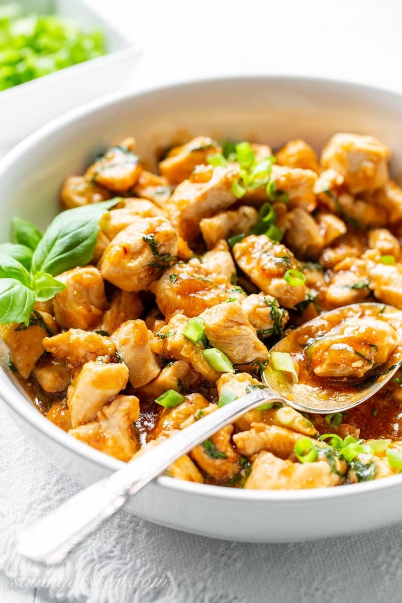 Spicy Basil Chicken with sliced green onions.