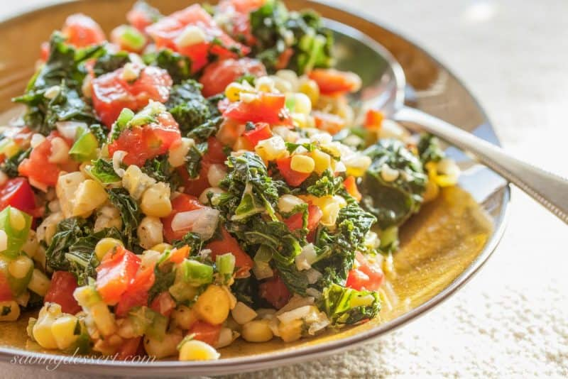 A bowl of Cajun flavored kale, corn and tomatoes