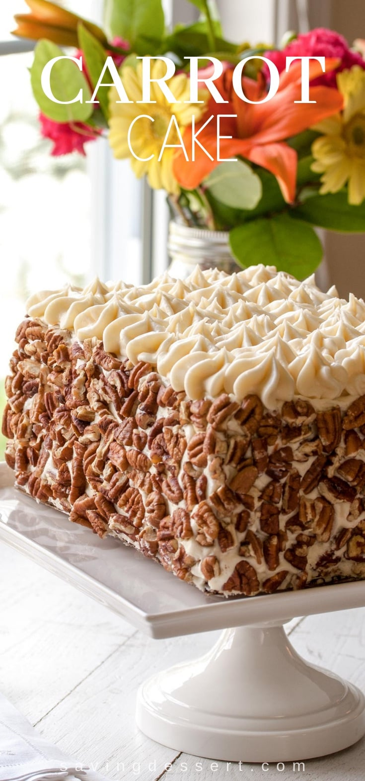 Classic Carrot Cake - a deliciously moist layer cake filled with carrots and topped with toasted pecans and a silky smooth cream cheese icing  #carrotcake #cake #creamcheeseicing #dessert #carrot #classiccake