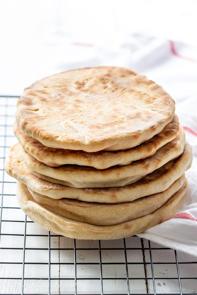 Try this slowly homemade whole wheat pita recipe adjacent fourth dimension you lot crave tender Whole Wheat Pita Recipe