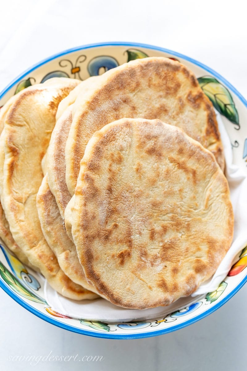 A bowl of fresh homemade whole wheat pita bread