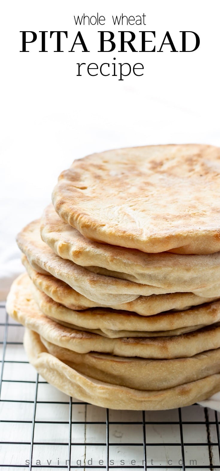 Try this easy homemade whole wheat pita recipe next time you crave tender, chewy pitas with a touch of honey for sweetness. #pitabread #pitarecipe #pita #flatbread #middleeasternbread #Greekfood #easypitabread #howtomakepitabread #pitabreadrecipe