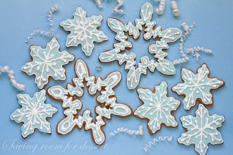 Snowflake gingerbread cookies decorated with icing and sparkly sugar