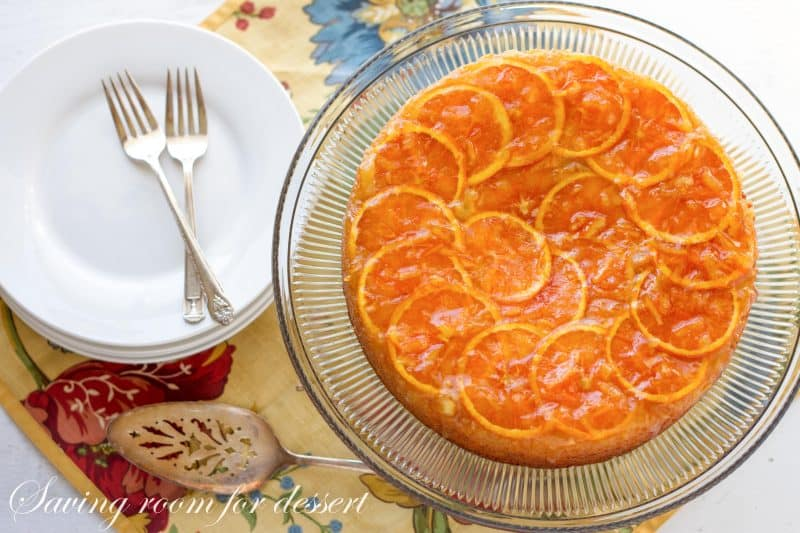 An orange marmalade cake on a cake stand