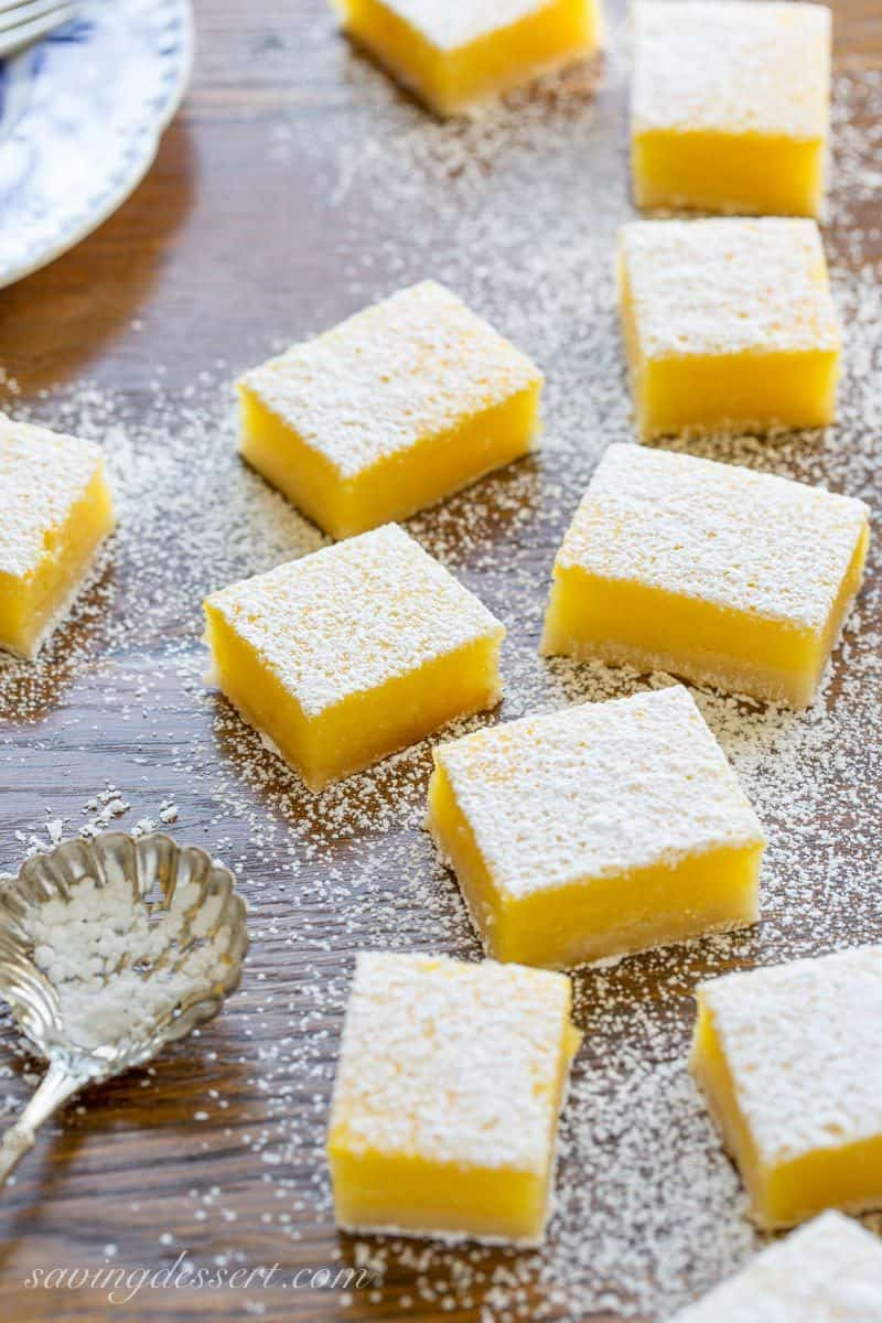 Lemon Bars cut into squares dusted with powdered sugar
