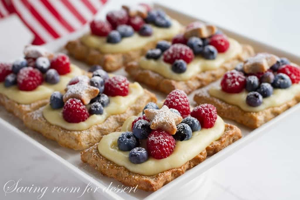 Star-Studded Berry Tarts with Vanilla Pastry Cream a delicious dessert with layers of flavor from the nutty crust, to a rich vanilla cream & juicy berries.