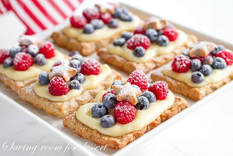 Star-studded berry tarts with vanilla pastry cream in a red, white and blue theme