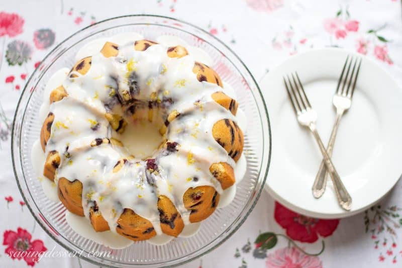 Blueberry Lemon Pound Cake - A deliciously moist classic pound cake stuffed full of ripe, juicy blueberries then drizzled with a simple lemon icing.