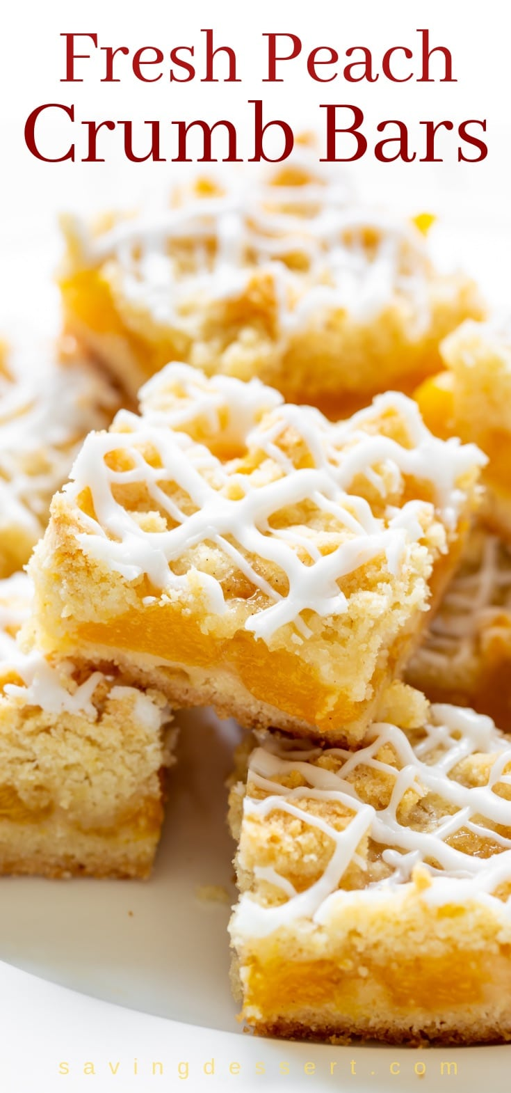 A plate stacked with fresh peach crumb bars drizzled with icing